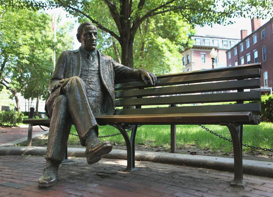 A statue of James Michael Curley near Faneuil Hall.